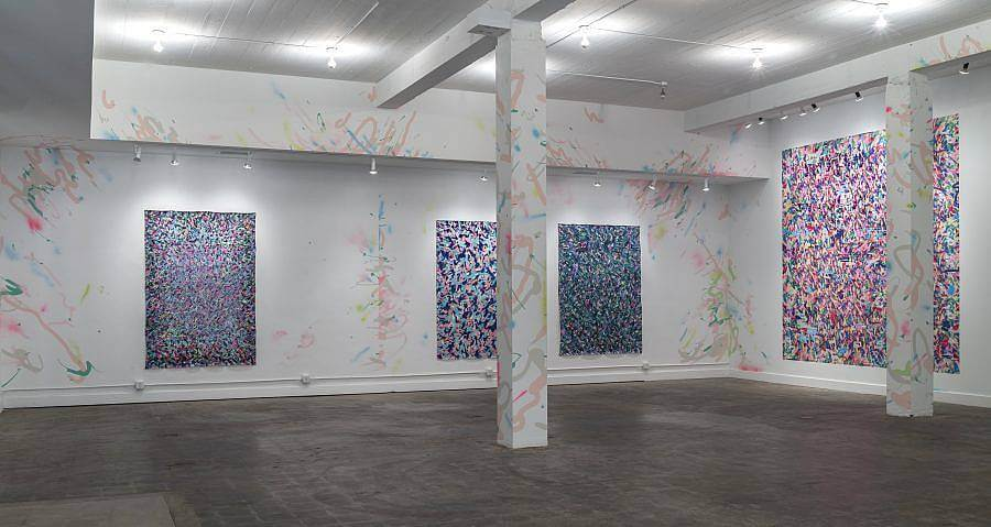 Image description: Featured in an installation view of 2016 Charlotte Street Visual Artist Awards  Exhibition at the Kemper Museum of Contemporary Art. In the exhibition there are four large paintings that have many small marks in various colors. The brushstrokes and marks continue onto the walls and supports in the gallery.