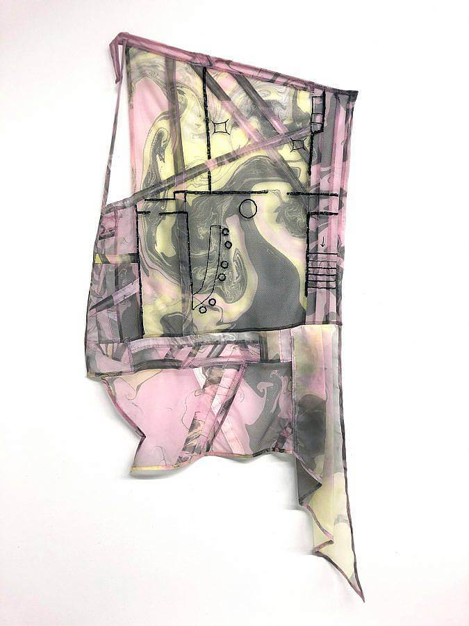 A marbled mesh polyerster of pinks, yellows and greys is embroidered with black thread. The thread depicts on outline of the layout of JackHammer bar.
