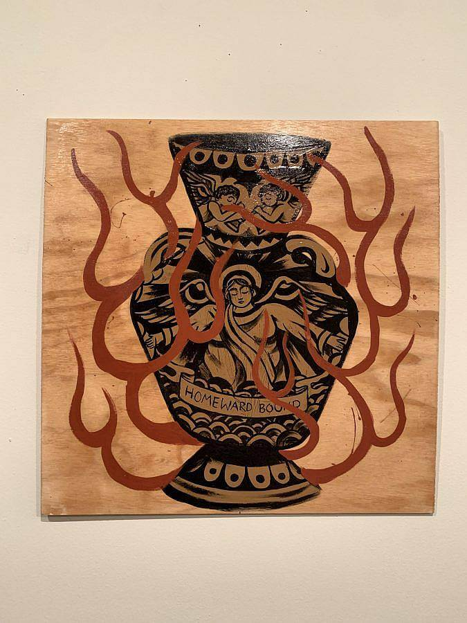 "Photo of a woodstain and latex painting on plywood. There is a vase with angels painted on it. A painted banner reads ""Homeward Bound,"" on the bottom of the vase. Red flame line work encircles the vase."