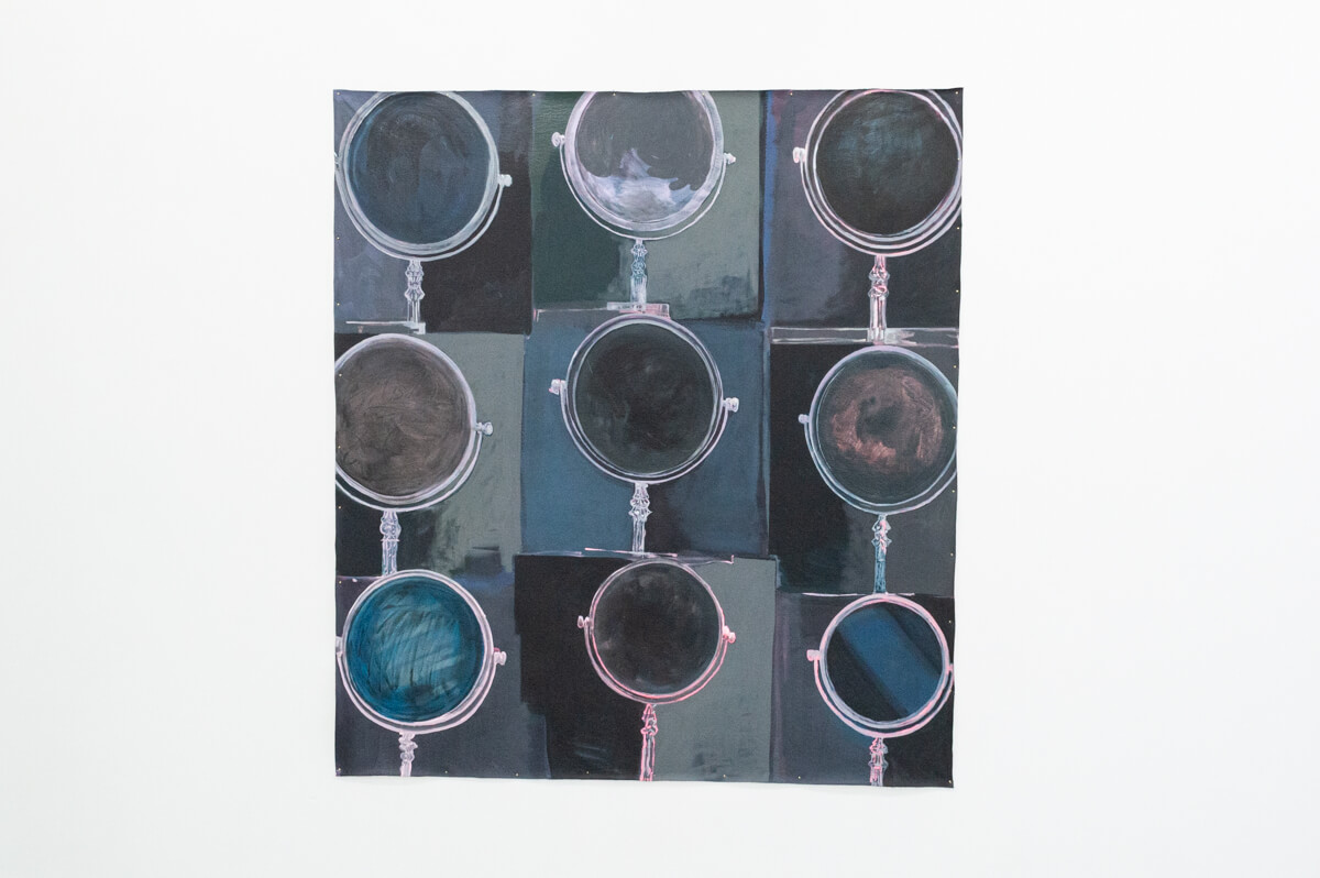 There is a painting with a slightly irregular grid of three images across and three images down. Each contains a circular vanity mirror, the outlines of which are done in light pinks and white. Inside and around the mirrors, the painting technique retains the texture of the paintbrush and is in shades of blue, gray, and purple.