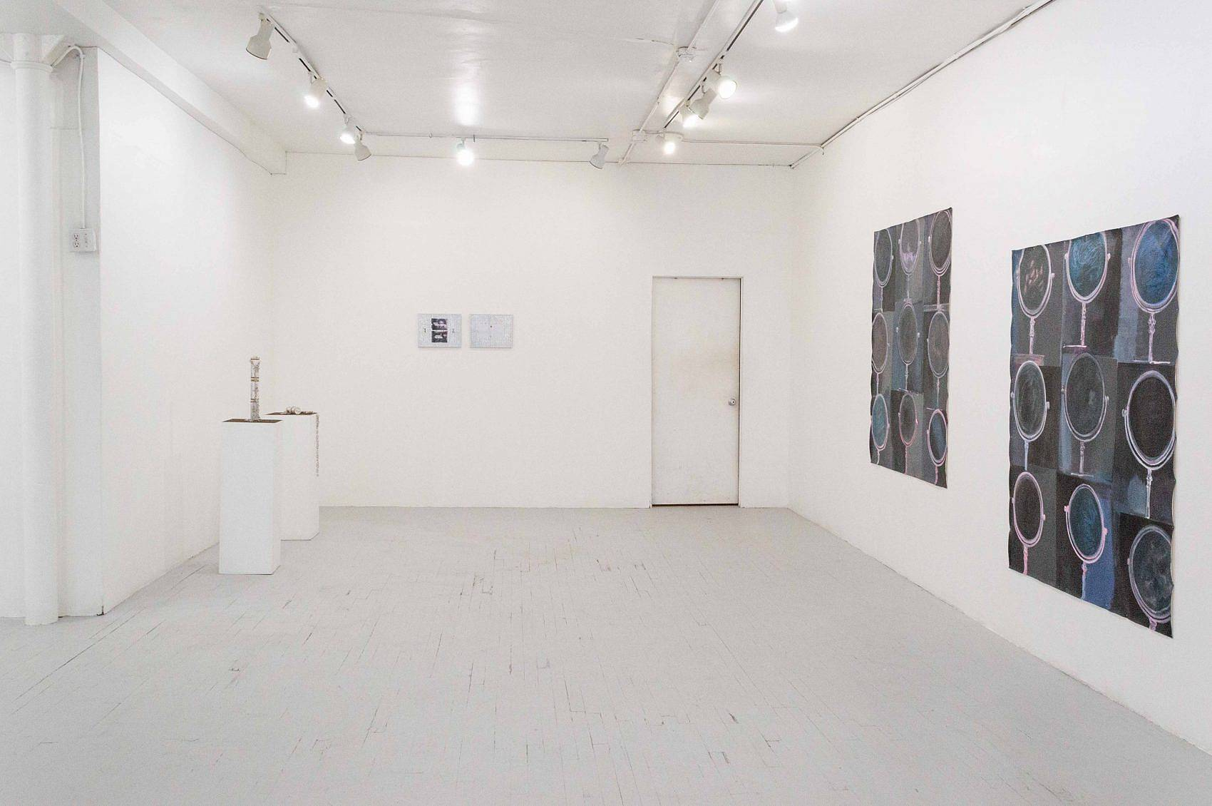 This is an installation shot of the exhibition. On the left wall is Zack Ingram's piece