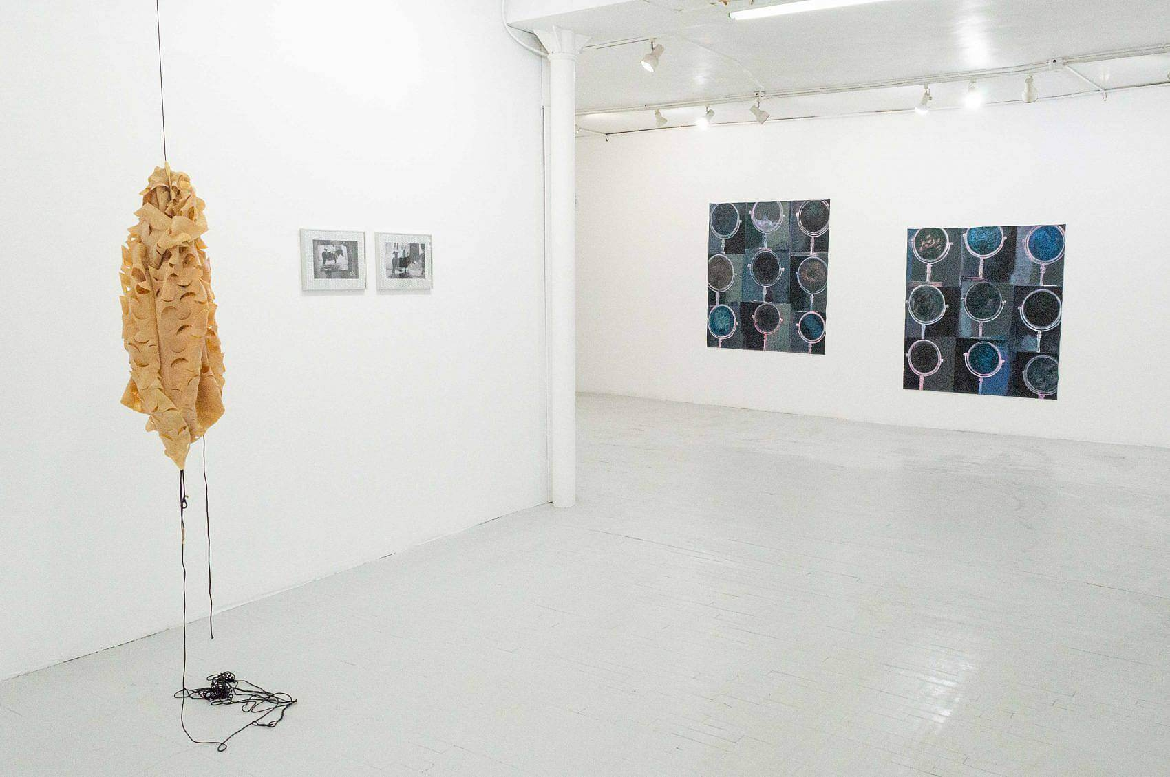 This is an installation shot of the exhibition. To the left, hanging in the space, is part of Zack Ingram's