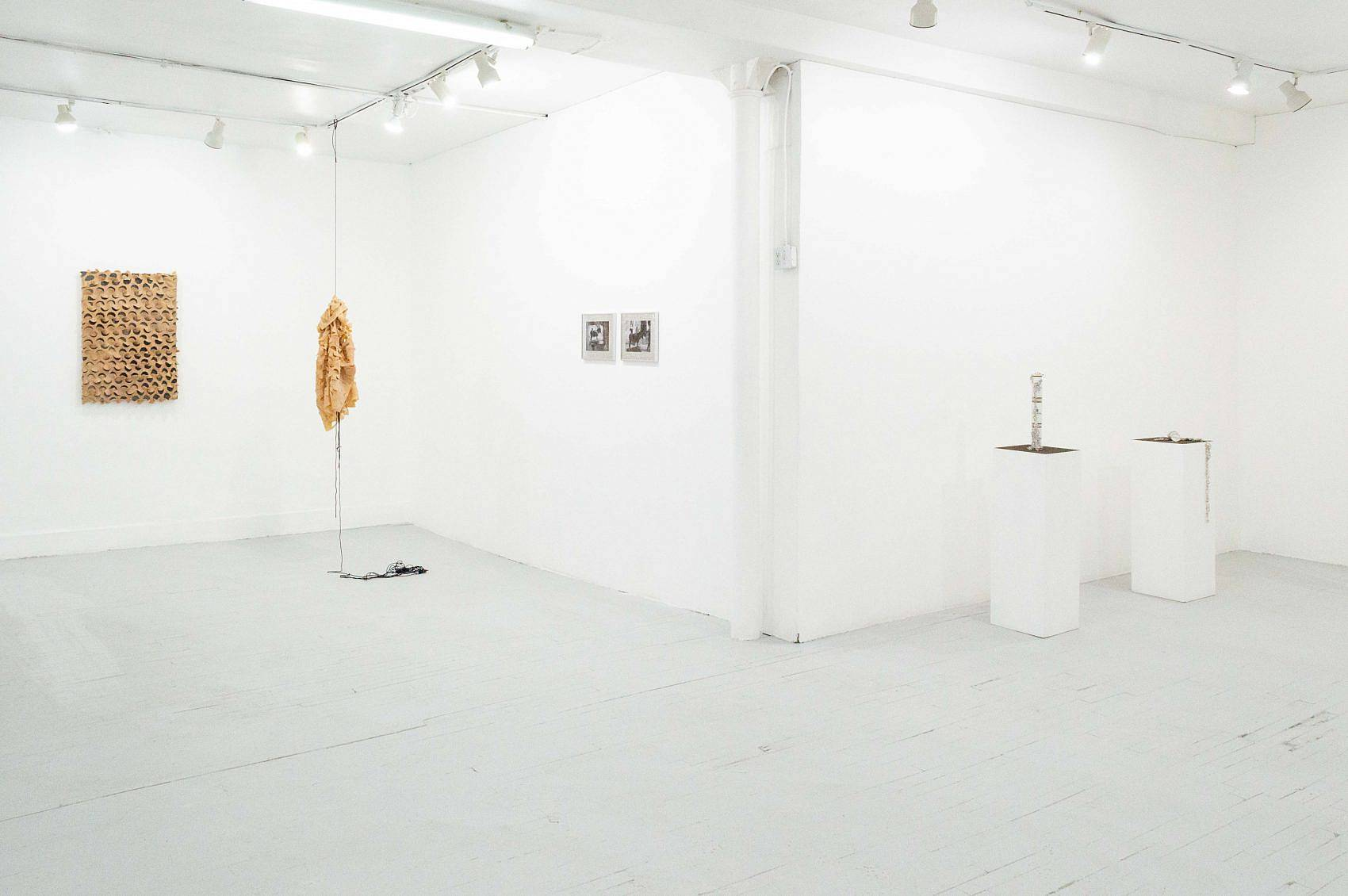 This is an installation shot of the exhibition. To the left is the hanging piece from Zack Ingram's