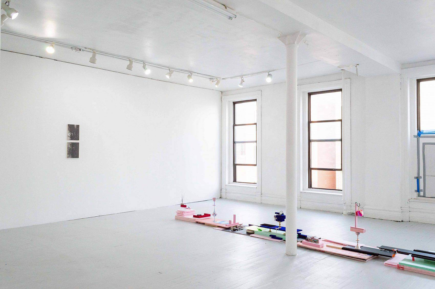 This is an installation shot of a corner of the exhibition. On the left wall is Zack Ingram's