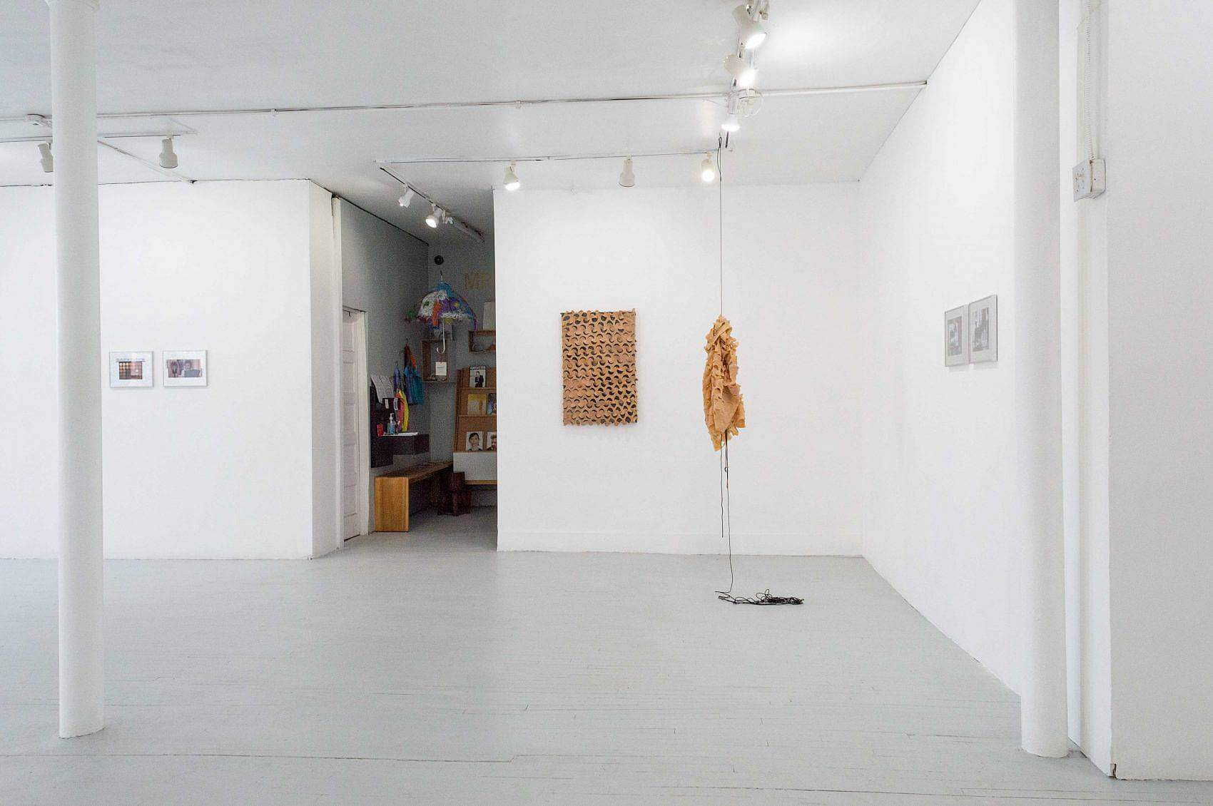 This is an installation shot of the exhibition with the entryway to the left and Zach Ingram's