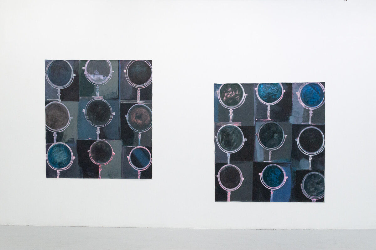 There are two large square paintings. The painting on the left is hung higher. Both paintings are made up of a grid of nine squares, each containing a circular vanity mirror. Both paintings have a cool-toned color palette of blues, grays, purples, and pinks.