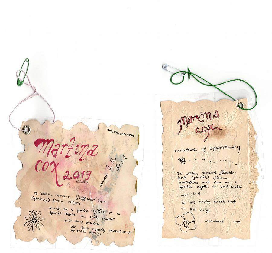 Image description: Scan of two hand made tags that each reach Martina Cox. They. look like burnt paper and are handwritten with washing and drying instructions.