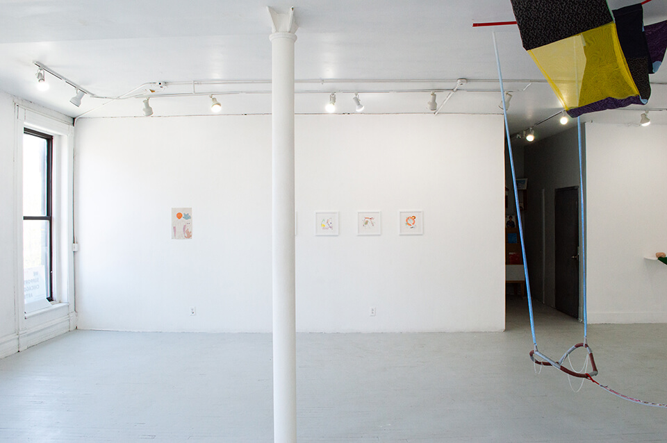 Image Description: This is an installation shot of the exhibition. On the wall directly ahead is