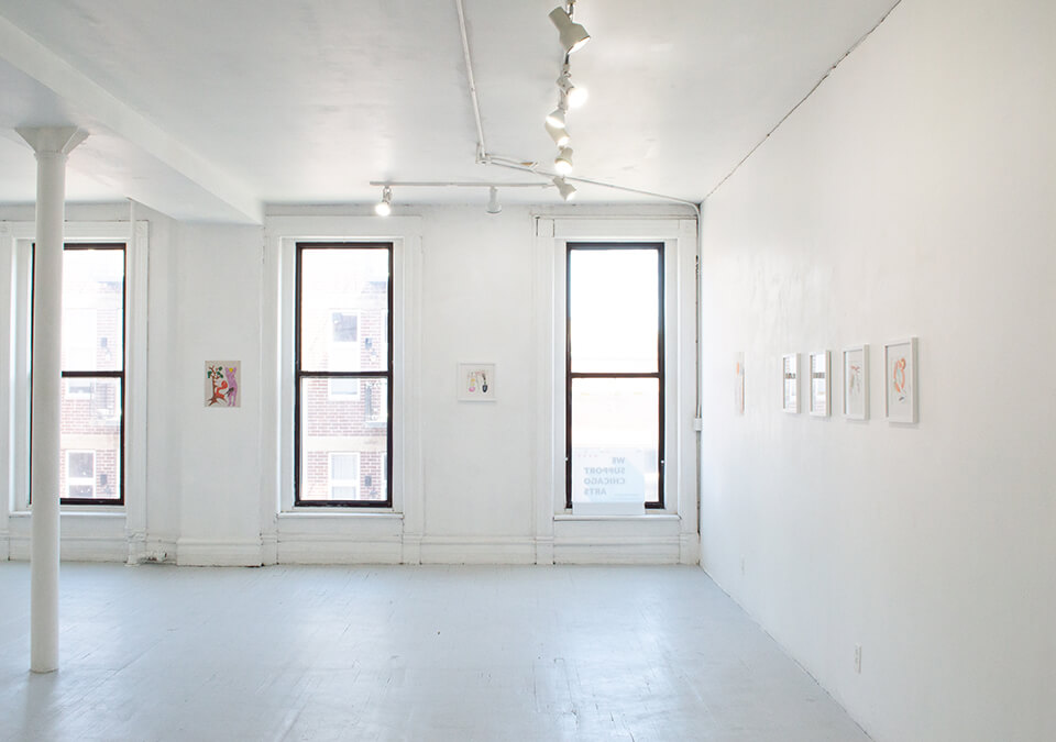 Image Description: This is an installation shot of the gallery facing the windows. In between the windows is