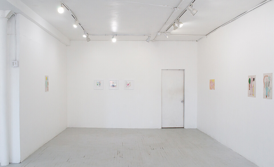 Image Description: This is an installation shot of one end of the gallery. Directly ahead are