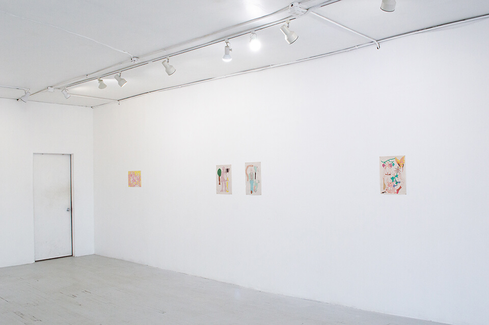 Image Description: This is an installation shot of one wall of the gallery featuring