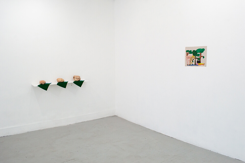 Image Description: This is an installation shot of a corner of the gallery. On the left wall is