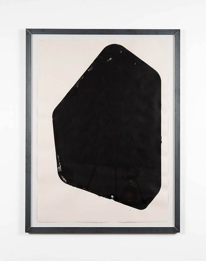 Image Description: A black block-printed shape with six sides on white paper in a welded metal frame.