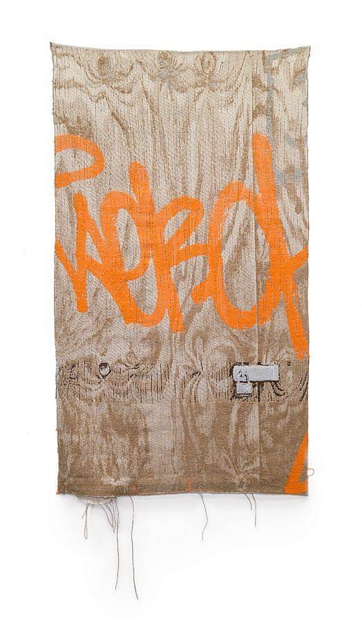 Image Description: This is a vertical horizontal weaving depicting a wooden shed door with a padlock. There are markings spray-painted on the door in fluorescent orange and the weaving is coming slightly undone at the bottom.
