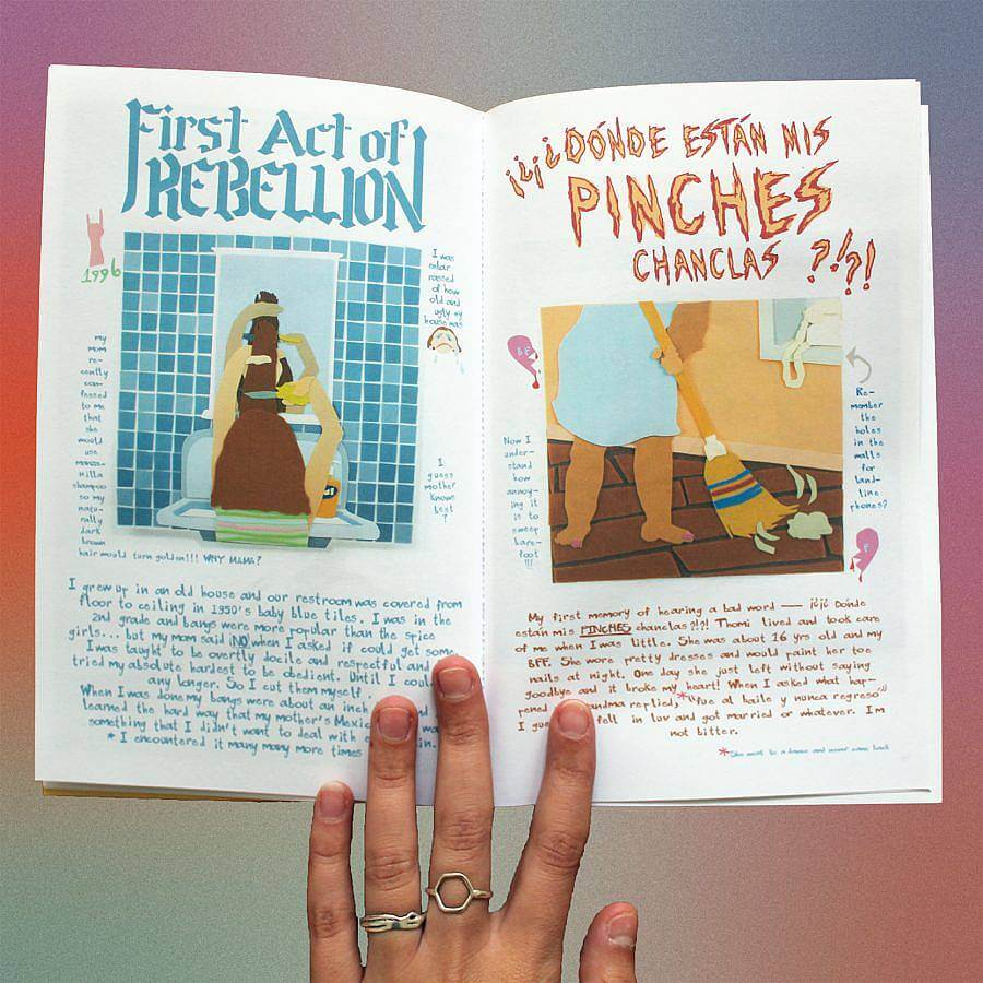 """Image description: A zine is turned open to a layout. On the left page reads """"First Act of Rebellion"""" in a blue medieval font, an illustration is depicted of someone cutting their hair in a blue tiled bathroom. Text below that dialogues this experience. The page on the left, in a yellow sketchy fire-like type reads """" ¿Dónde están mis pinches chanclas ?!?!"""" in all caps. An illustration of someone with olive skin holds a broom and is sweeping the floor."""
