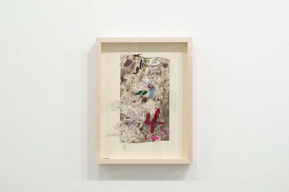 Image description: This is a work by Justin Nalley titled; Untitled (Studio Floor 041621—mislabeled as 041620). This work resembles a collection of dust and debris that is stuck to a large piece of tape and is framed in a wooden, recessed, rectangular frame.