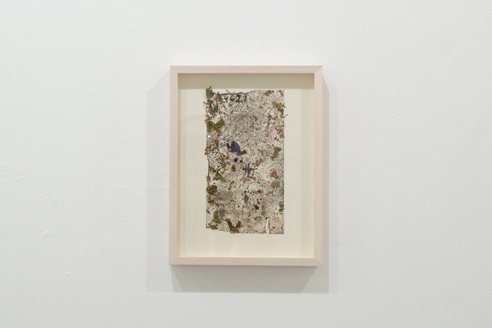 Image description: This is a work by Justin Nalley titled; Untitled (Studio Floor 040621). This work resembles a collection of dust and debris that is stuck to a large piece of tape and is framed in a wooden, recessed, rectangular frame.