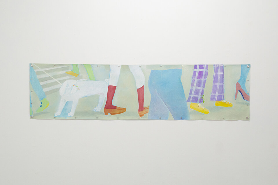 Image description: This is a photograph of a painting titled A dog and a mantis by Minami Kobayashi. It is a wide painting that is not stretched, it is hung on the wall with nails and grommets. The painting is primarily light green and shows various feet of pedestrians and animals passing by.