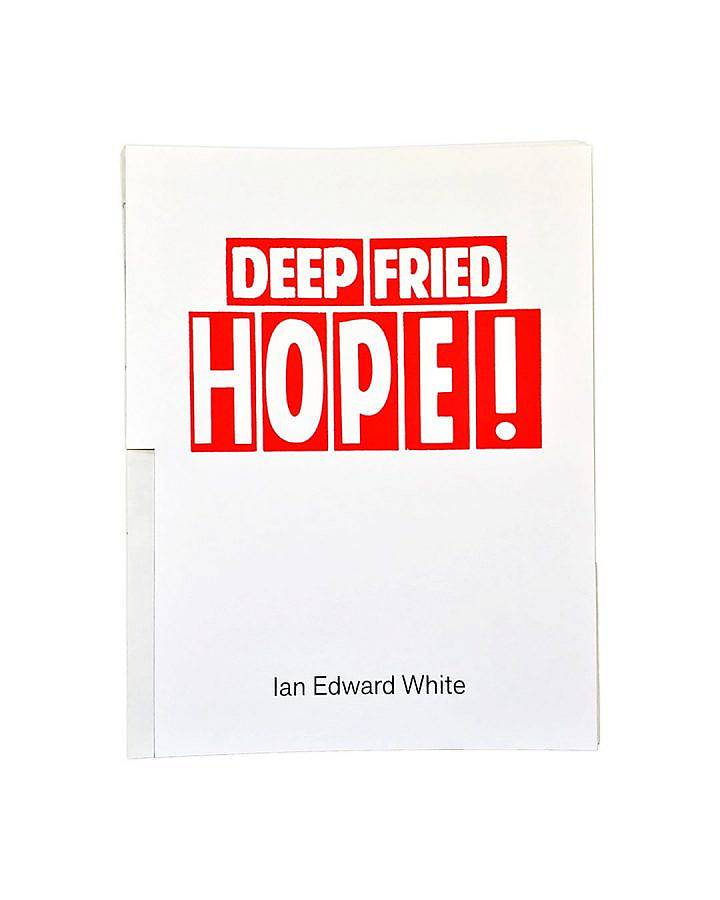 """image description: this image features the cover of a book published by soup press in 2020. The artist's name: Ian Edward White is printed unblock ink near the bottom of the front cover and the title """"Deep Fried Hope"""" is printed in red ink, back letter of the title is enclosed in a red box. On the left hand side the lower half of the book's spine is exposed."""